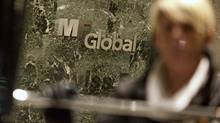A woman leaves the office complex where MF Global Holdings Ltd have an office on 52nd Street in midtown Manhattan October 29, 2011. (ANDREW KELLY/Reuters)