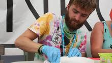 Cameron Butler from Nelson, B.C. tests drugs at the Ankors tent at Shambhala Music Festival. (Alexandra Posadzki / The Globe and Mail)