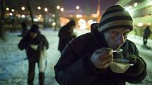 A homeless man gets a hot meal from a soup truck courtesy of the Nochlezhka homeless shelter in St. Petersburg January 18, 2014. (John Lehmann/The Globe and Mail)