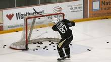 Pittsburgh Penguins Sidney Crosby shoots a puck into the net on the first day of NHL hockey training camp at their practice facility outside Pittsburgh. (JASON COHN/REUTERS)