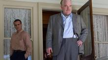"""Joaquin Phoenix, left, and Philip Seymour Hoffman in a scene from """"The Master"""" (AP)"""