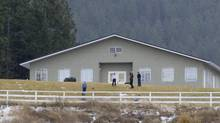 Kids are seen playing outside of one of the two schools in the polygamist community of Bountiful, B.C. on Nov. 23, 2011. (Jonathan Hayward/The Canadian Press)