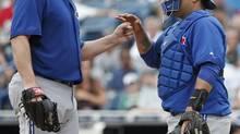 Toronto Blue Jays catcher Dioner Navarro congratulates starting pitcher Mark Buehrle (Kathy Willens/AP Photo)