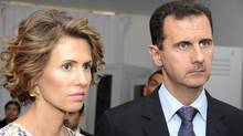 Syrian President Bashar Assad and his wife Asma. (Hassene Dridi/ASSOCIATED PRESS)