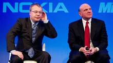 Nokia chief executive Stephen Elop, left, and Microsoft CEO Steve Ballmer during the Nokia Strategy and Financial Briefing at the Intercontinental Hotel in central London, on Feb. 11, 2011. (LEON NEAL/AFP/Getty Images)