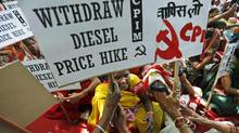 Supporters of Communist Party of India (Marxist) participate in a protest with placards in New Delhi, Sept. 20, 2012. (Saurabh Das/AP)