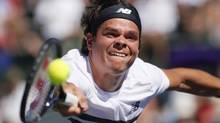 Milos Raonic of Canada returns a shot against Jo-Wilfried Tsonga of France during their match at the BNP Paribas Open ATP tournament in Indian Wells, California, March 13, 2013. (DANNY MOLOSHOK/REUTERS)
