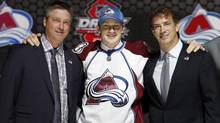 Nathan Mackinnon poses with Colorado Avalanche coach Patrick Roy and executive vice-president of hockey operations Joe Sakic after he was selected by the Avalanche as the first overall pick in the 2013 National Hockey league draft in Newark, N.J., June 30, 2013