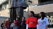 """Nelson Mandela's grandchildren, Swati Mandela-Dlamini and Zaziwe Manaway pose with shirts from their range """"Long Walk to Freedom Clothing"""" on July 11, 2012 in Johannesburg, South Africa. The range of Madiba-linked T-shirts will be sold on the internet. (Gallo Images/Getty Images)"""