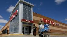 Shoppers leave a Toronto Metro store. (Peter Power/The Globe and Mail)