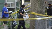 Toronto detectives collect evidence at the murder scene where two teens were gunned down in the Jane and Finch area of Toronto, August 23, 2013. (J.P. Moczulski for The Globe and Mail)