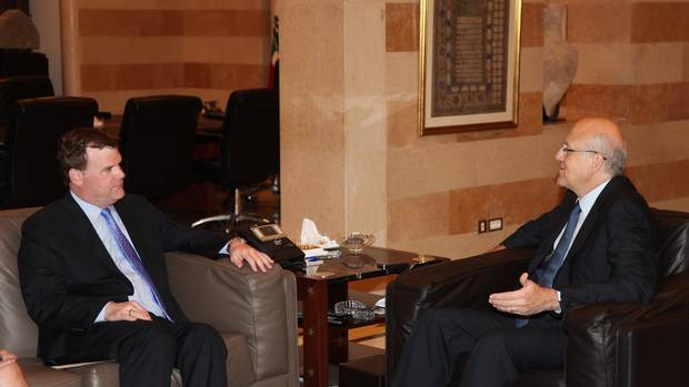 Lebanon's Prime Minister Najib Mikati (R) meets Canada's Foreign Minister John Baird at the government palace in Beirut August 10, 2012.