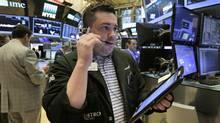 Trader Joseph Lawler works on the floor of the New York Stock Exchange, Friday, June 16. (Richard Drew/AP)