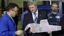 Prime Minister Stephen Harper visits a Heroux-Devtek in Montreal on Jan. 14, 2011. (SHAUN BEST/Reuters/SHAUN BEST/Reuters)