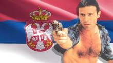 Rob Stewart as Nick Slaughter in the Canadian TV series Sweating Bullets, known outside the country as Tropical Heat. The Serbian flag is behind him.