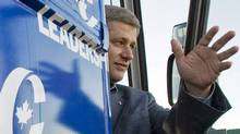 Stephen Harper waves from his campaign bus upon his arrival in Val D'Or, Que., during the 2008 election campaign. (Tom Hanson/The Canadian Press)