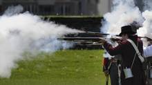 Militia re-enactors fire a fusillade during activities at Fort York in Toronto on May, 21 2012. (Fred Lum/The Globe and Mail)