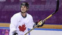 Team Canada forward Martin St. Louis and his teammates take part in their first men's hockey practice during the 2014 Sochi Winter Olympics in Sochi, Russia on Monday, February 10, 2014. (The Canadian Press)