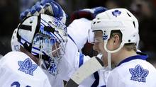 Toronto Maple Leafs right wing Joey Crabb (46) congratulates goaltender James Reimer (34) following an NHL hockey game against the Colorado Avalanche on Thursday, March 24, 2011, in Denver. Toronto beat Colorado 4-3. (AP Photo/Jack Dempsey) (Jack Dempsey)