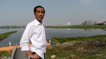 Bloomberg Photo Service 'Best of the Week': Joko Widodo, governor of Jakarta and presidential candidate, visits the Pluit Dam area in Jakarta, Indonesia, on Tuesday, July 22, 2014. Indonesia's election commission moved to count the final provinces in a presidential vote forecast to show Widodo, known as Jokowi, as the winner. Photographer: Dimas Ardian/Bloomberg *** Local Caption *** Joko Widodo (Dimas Ardian/Bloomberg)