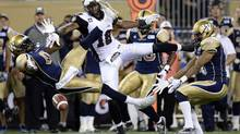 Winnipeg Blue Bombers Johnny Sears Jr. and Matt Bucknor break up a pass intended for Ottawa RedBlacks Marcus Henry (FRED GREENSLADE/REUTERS)