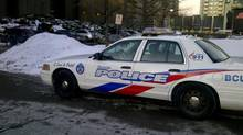 A police car sits outside a Toronto District School Board meeting on March 5, 2014. (CAROLINE ALPHONSO/THE GLOBE AND MAIL)
