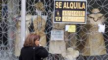 "A woman passes a shop with a sign which reads ""For Rent"" in Madrid April 27, 2012. Borrowing costs in a debt auction rose on Thursday. (SERGIO PEREZ/SERGIO PEREZ/REUTERS)"