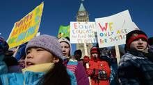 Children take part in a protest on Parliament Hill on Feb. 14, 2013, calling for equal education for First Nations. (Sean Kilpatrick/THE CANADIAN PRESS)