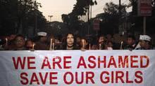 Indian women participate in a silent procession to mourn the death of a gang rape victim, in Gauhati, India, Saturday, Dec. 29, 2012. (Anupam Nath/AP)