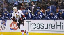 Ottawa Senators' Dion Phaneuf skates past the Toronto Maple Leafs bench during first period NHL hockey action in Toronto on Saturday March 5, 2016. (Chris Young/THE CANADIAN PRESS)