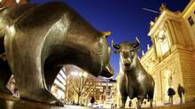 The bull and bear bronze statues stand outside the stock market in Frankfurt, Germany, Dec.12, 2011. (Michael Probst/AP/Michael Probst/AP)
