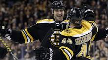 Boston Bruins defenseman Zdeno Chara celebrates with defenseman Dennis Seidenberg after Seidenberg scored against the Tampa Bay Lightning in the second period of an NHL hockey game in Boston, Tuesday, March 27, 2012. (Elise Amendola/Associated Press)