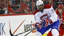 Montreal Canadiens' P.K. Subban controls the puck as Carolina Hurricanes' Eric Staal chases during the first period of an NHL hockey game in Raleigh, N.C., Thursday, April 5, 2012. (Gerry Broome/Gerry Broome/AP)
