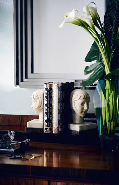 COMBINE AND CONSTRAST As you'll likely note in Baz Luhrmann's upcoming (3D!) Great Gatsby flick, black, white and metallic tones are integral to the art-deco palette. This vignette, built around a pair of vintage ivory bookends atop a polished walnut cabinet, blends all three to dramatic effect. (Michael Graydon for The Globe and Mail/Michael Graydon for The Globe and Mail)