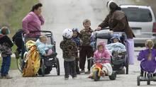 Members of the polygamous community of Bountiful, B.C. walk down a road near Creston, B.C. Monday, April 21, 2008. (Jonathan Hayward/ The Canadian Press/Jonathan Hayward/ The Canadian Press)