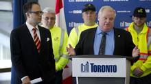 Councillor Denzil Minnan-Wong, who also serves as chair of the public works committee, and Mayor Rob Ford hold a press conference to discuss the the future of garbage removal in Toronto. (Kevin Van Paassen/The Globe and Mail)