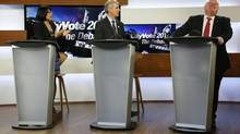 Mayor Rob Ford (R) laughs as he takes part in a Toronto Mayoral election debate with candidates Olivia Chow (L) and David Soknacki in Toronto, March 26, 2014. (MARK BLINCH/REUTERS)