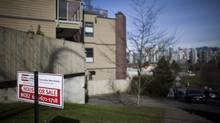 A for-sale sign outside condos overlooking the skyline in the Fairview neighbourhood of Vancouver, March 4, 2013. (Rafal Gerszak for The Globe and Mail)