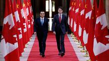 Justin Trudeau and Chinese Premier Li Keqiang at Parliament Hill on Sept. 22, 2016. Recent mutual visits between Canadian and Chinese leadership resulted in an unprecedented level of warmth, but just less than half of companies believe Mr. Trudeau's visit to China was somewhat or very positive. (Chris Wattie/Reuters)