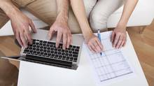 Young couple doing finances at laptop (AndreyPopov/Getty Images/iStockphoto)