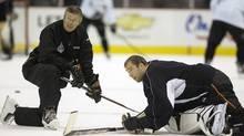 Goaltending coach Francois Allaire talks with goaltender Jean-Sebastien Giguere, then with Anaheim, in 2007