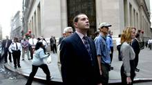 At 8:46 a.m. on Sept. 11, 2011, the first plane hit the World Trade Center's North Tower, stopping stockbrokers and passersby in their tracks outside the New York Stock Exchange. (Ting-Li Wang/THE NEW YORK TIMES)