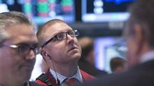 Traders work on the floor of the New York Stock Exchange May 5, 2014. (BRENDAN MCDERMID/REUTERS)
