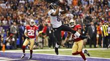 Baltimore Ravens wide receiver Anquan Boldin catches a touchdown pass in front of San Francisco 49ers strong safety Donte Whitner during the first quarter in the NFL Super Bowl XLVII football game in New Orleans, Louisiana, February 3, 2013. (JEFF HAYNES/REUTERS)