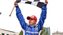 Forsythe racing driver A.J. Allmendinger stands on his car to celebrate after winning the Grand Prix of Toronto on Sunday July 9, 2006 (File photo). (Frank Gunn/CP Photo)