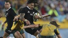 New Zealand All Black Ma'a Nonu is tackled by Australian Wallabies Michael Hooper during their Bledisloe Cup rugby test match against the in Sydney, Australia, Saturday, Aug. 16. (Rob Griffith/AP)