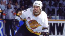 Nathan Lafayette , Vancouver Canuck, shown in action against the NY Rangers in 1994 Stanley Cup action. HHOF Images