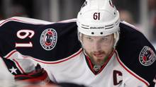 In this Feb. 19, 2012, file photo, Columbus Blue Jackets' Rick Nash (61) watches a face off during the third period of an NHL hockey game against the New York Rangers at New York's Madison Square Garden. The NHL trade deadline is Monday and contenders have to decide if they want to risk the future to win now. Columbus captain Rick Nash is available and it seems every team is in talks with the Blue Jackets about acquiring the star.(AP Photo/Kathy Willens, File) (Kathy Willens/AP)