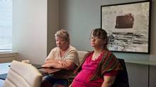 Patricia Seth, left, and Marie Slark, former Huronia Regional Centre residents, were plaintiffs in the class action proceeding against the Ontario government. (Galit Rodan/The Canadian Press)