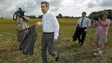 Liberal Leader Michael Ignatieff and his infrastructure critic, MP Gerard Kennedy, leave a farmer's field in Burlington, Ont., after a press conference on Sept. 24, 2009. (Darren Calabrese/The Canadian Press)